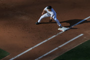 Chase Utley #26 of the Los Angeles Dodgers covers first base during the second inning of a game against the Philadelphia Phillies at Dodger Stadium on May 28, 2018 in Los Angeles, California.  MLB players across the league are wearing special uniforms to commemorate Memorial Day.