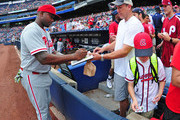 Ryan Howard #6 of the Philadelphia Phillies signs autographs before the game against the Atlanta Braves at Turner Field on July 30, 2016 in Atlanta, Georgia.