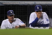 (L-R) Pitching coach Rick Honeycutt and manager Joe Torre of the Los Angeles Dodgers watch from the dugout in the ninth inning against the Philadelphia Phillies in Game One of the NLCS during the 2009 MLB Playoffs at Dodger Stadium on October 15, 2009 in Los Angeles, California.