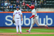 Rhys Hoskins #17 of the Philadelphia Phillies gestures as he passes Jay Bruce #19 of the New York Mets after he hit a two-run home run against the New York Mets during the first inning of a game at Citi Field on September 9, 2018 in the Flushing neighborhood of the Queens borough of New York City.