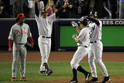 (R-L) Derek Jeter #2, Johnny Damon #18 and Jorge Posada #20 of the New York Yankees celebrate after Damon and Jeter scored on a 2-run single by Hideki Matsui #55 as Pedro Martinez #45 of the Philadelphia Phillies looks on in the bottom of the third inning of Game Six of the 2009 MLB World Series at Yankee Stadium on November 4, 2009 in the Bronx borough of New York City.