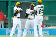 Starling Marte #6, Andrew McCutchen #22 and Gregory Polanco #25 of the Pittsburgh Pirates celebrate after a 6-2 win over the Philadelphia Phillies on July 6, 2014 at PNC Park in Pittsburgh, Pennsylvania.