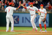 Andres Blanco #4 of the Philadelphia Phillies celebrates with Maikel Franco #7 after a 4-3 victory against the Washington Nationals at Nationals Park on April 26, 2016 in Washington, DC.