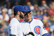 Anthony Rizzo #44 of the Chicago Cubs (R) congratulates Brandon Morrow #15 after Morrow caught a line drive in the 9th inning against the Philadelphia Phillies at Wrigley Field on June 7, 2018 in Chicago, Illinois. The Cubs defeated the Phillies 4-3.