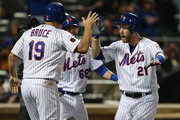 Jay Bruce #19, Jeff McNeil #68 and Todd Frazier #21 of the New York Mets congratulate each other after scoring on a double by Tomas Nido #3 against the Philadelphia Phillies during the second inning of a game at Citi Field on September 8, 2018 in the Flushing neighborhood of the Queens borough of New York City. The Mets defeated the Phillies 10-5.