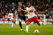 Roy Miller #7 of New York Red Bulls carries the ball in front of Sebastien Le Toux #11 of Philadelphia Union at Red Bull Arena on April 16, 2014 in Harrison, New Jersey. Red Bulls defeated the Union 2-1.