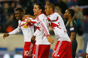 Lloyd Sam #10 of the New York Red Bulls is mobbed by teammates Tim Cahill #17 and Roy Miller #7 after scoring in the 67th minute against the Philadelphia Union at Red Bull Arena on April 16, 2014 in Harrison, New Jersey. Red Bulls defeated the Union 2-1.