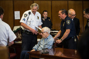 Anthony Marshall, (C), son of Brooke Astor, is taken away by court officials after attending his sentencing at Manhattan Criminal Courts on June 21, 2013 in New York City. Marshall, age 89, was found guilty of stealing millions from his mother's estate, and has been sentenced to serve one year of his three year term.