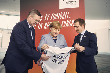 Philipp Lahm Reinhard Grindel And Philipp Lahm Visit German Chancellor Angela Merkel