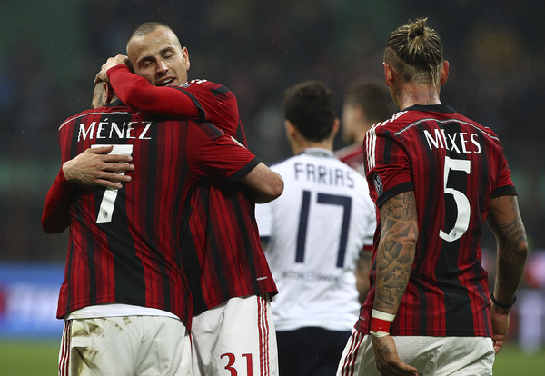 AC Milan v Cagliari Calcio - Serie A [player,team sport,team,football player,soccer player,sports,ball game,tournament,sports equipment,championship,ac milan,cagliari calcio,serie a,milan,l,r,c,jeremy menez,luca antonelli,philippe mexes]