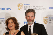 (UK TABLOID NEWSPAPERS OUT) Rebecca Front and Pater Capaldi pose with their best male and female comedy performance awards in front of the winners boards at The Philips British Academy Television Awards held at The Palladium on June 6, 2010 in London, England.