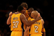 (L-R) Ron Artest #37, Pau Gasol #16, Kobe Bryant #24 and Derek Fisher #2 of the Los Angeles Lakers huddle together in Game Two of the Western Conference Finals against the Phoenix Suns during the 2010 NBA Playoffs at Staples Center on May 19, 2010 in Los Angeles, California. NOTE TO USER: User expressly acknowledges and agrees that, by downloading and/or using this Photograph, user is consenting to the terms and conditions of the Getty Images License Agreement.