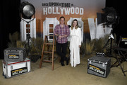 """Director Quentin Tarantino and Margot Robbie attend the photo call for Columbia Pictures' """"Once Upon A Time In Hollywood"""" at Four Seasons Hotel Los Angeles at Beverly Hills on July 11, 2019 in Los Angeles, California."""