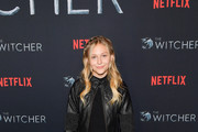 """Alyvia Alyn Lind attends the photocall for Netflix's """"The Witcher"""" season 1 at the Egyptian Theatre on December 03, 2019 in Hollywood, California."""