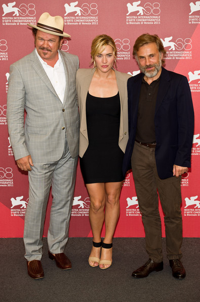 (L-R) Actors John C. Reilly, Kate Winslet and Christoph Waltz pose at the 'Carnage' photocall at the Palazzo del Casino on September 1, 2011 in Venice, Italy..