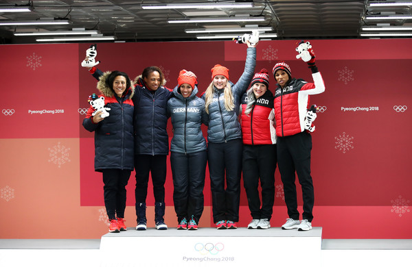 Bobsleigh - Winter Olympics Day 12 [red,team,stage equipment,technology,podium,event,electronic device,elana meyers taylor,lauren gibbs,l-r,gold,silver,bronze,united states,canada,womens bobsleigh,winter olympics]