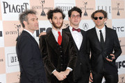 (L-R) Actor Ronald Bronstein, Directors Josh Safdie and Benny Safdie and producer Casey Neistat arrive at the 2011 Film Independent Spirit Awards at Santa Monica Beach on February 26, 2011 in Santa Monica, California.
