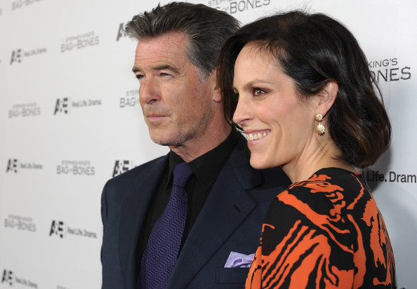 "Pierce Brosnan Actor Pierce Brosnan and actress Annabeth Gish attend A&E's premiere party event for Stephen King's ""Bag of Bones"" at Fig & Olive Melrose Place on December 8, 2011 in West Hollywood, California."