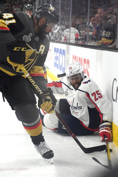 2018 NHL Stanley Cup Final - Game One [college ice hockey,ice hockey,sports gear,ice hockey equipment,hockey protective equipment,hockey pants,ice hockey position,player,jersey,hockey,game one,devante smith-pelly 25,pierre-edouard bellemare,puck,t-mobile arena,nhl,vegas golden knights,washington capitals,stanley cup final,battle]
