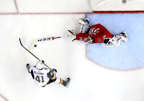 2018 NHL Stanley Cup Final - Game Three [ice hockey,ice hockey position,hockey,stick and ball games,team sport,college ice hockey,ice hockey equipment,goaltender,jersey,sports gear,braden holtby,three,game,puck,poke-checks,game three,washington capitals,nhl,vegas golden knights,stanley cup final]