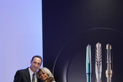 Pineider General Director Giuseppe Rossi and Corice Arman attend the Pineider Arman Tribute presentation on November 20, 2019 in Milan, Italy.