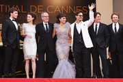 """(L-R) Actors Sam Claflin, Astrid Berges-Frisbey, Geoffrey Rush,  Penelope Cruz, Johnny Depp, and director Rob Marshall, and producer Jerry Bruckheimer depart the """"Pirates of the Caribbean: On Stranger Tides"""" premiere at the Palais des Festivals during the 64th Cannes Film Festival on May 14, 2011 in Cannes, France."""