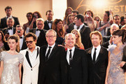 """(L-R) Actors Astrid Berges-Frisbey, Johnny Depp, Geoffrey Rush, guest, Jerry Bruckheimer, and Penelope Cruz depart the """"Pirates of the Caribbean: On Stranger Tides"""" premiere at the Palais des Festivals during the 64th Cannes Film Festival on May 14, 2011 in Cannes, France."""