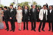 """(L-R) Actress Penelope Cruz,director Rob Marshall and actors Sam Claflin,Astrid Berges-Frisbey, producer Jerry Bruckheimer and actors Geoffrey Rush .,Johnny Depp,Ian McShane attend the """"Pirates of the Caribbean: On Stranger Tides"""" premiere at the Palais des Festivals during the 64th Cannes Film Festival on May 14, 2011 in Cannes, France."""