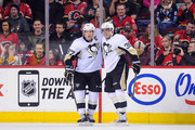 Sidney Crosby #87 congratulates David Perron #39 after he scored a goal against the Calgary Flames during an NHL game at Scotiabank Saddledome on February 6, 2015 in Calgary, Alberta, Canada.