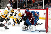 Goalie Semyon Varlamov #1 of the Colorado Avalanche saves a shot on goal in the third period by Carter Rowney #37 of the Pittsburgh Penguins at the Pepsi Center on December 18, 2017 in Denver, Colorado.