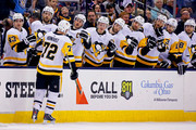 Patric Hornqvist #72 of the Pittsburgh Penguins is congratulated by his teammates after scoring a goal during the first period of the game against the Columbus Blue Jackets on April 5, 2018 at Nationwide Arena in Columbus, Ohio.