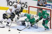 Antti Niemi #31 of the Dallas Stars and John Klingberg #3 of the Dallas Stars defend against Patric Hornqvist #72 of the Pittsburgh Penguins and David Perron #57 of the Pittsburgh Penguins in the third period at American Airlines Center on October 8, 2015 in Dallas, Texas.