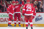 Frans Nielsen #51 of the Detroit Red Wings celebrates his second period goal with teammates Justin Abdelkader #8 and Mike Green #25 during an NHL game against the Pittsburgh Penguins at Little Caesars Arena on December 31, 2017 in Detroit, Michigan.