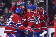 The Montreal Canadiens celebrate a goal by Tomas Tatar #90 of the Montreal Canadiens (not pictured) against the Pittsburgh Penguins during the NHL game at the Bell Centre on October 13, 2018 in Montreal, Quebec, Canada.