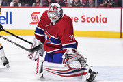 Goaltender Antti Niemi #37 of the Montreal Canadiens makes a glove save against the Pittsburgh Penguins during the NHL game at the Bell Centre on October 13, 2018 in Montreal, Quebec, Canada.  The Montreal Canadiens defeated the Pittsburgh Penguins 4-3 in a shootout.