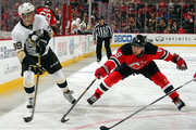 David Perron #39 of the Pittsburgh Penguins looks to pass defended by Dainius Zubrus #8 of the New Jersey Devils during the third period at the Prudential Center on January 30, 2015 in Newark, New Jersey.