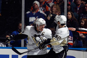 Sidney Crosby #87 of the Pittsburgh Penguins celebrates his goal at 19:55 of the second period against the New York Islanders along with Kris Letang #58 at the Nassau Veterans Memorial Coliseum on January 16, 2015 in Uniondale, New York.