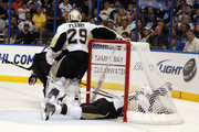 Brooks Orpik #44 of the Pittsburgh Penguins slides into the net while teammate Goaltender Marc-Andre Fleury #29  defends against the Tampa Bay Lightning in Game Three of the Eastern Conference Quarterfinals during the 2011 NHL Stanley Cup Playoffs at the St. Pete Times Forum on April 18, 2011 in Tampa, Florida.