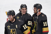 James Neal #18, Erik Haula #56 and Jon Merrill #15 of the Vegas Golden Knights celebrate after Merrill scored a third-period goal against the Pittsburgh Penguins during their game at T-Mobile Arena on December 14, 2017 in Las Vegas, Nevada. The Golden Knights won 2-1.
