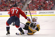 T.J. Oshie #77 of the Washington Capitals checks Patric Hornqvist #72 of the Pittsburgh Penguins during the second period in Game Two of the Eastern Conference Second Round during the 2018 NHL Stanley Cup Playoffs at Capital One Arena on April 29, 2018 in Washington, DC.