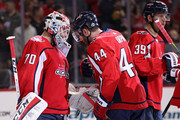Braden Holtby #70 of the Washington Capitals and Brooks Orpik #44 celebrate after defeating the Pittsburgh Penguins in Game Two of the Eastern Conference Second Round during the 2018 NHL Stanley Cup Playoffs at Capital One Arena on April 29, 2018 in Washington, DC.