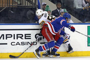 Marc Staal #18 of the New York Rangers hits Jake Guentzel #59 of the Pittsburgh Penguins at Madison Square Garden on March 14, 2018 in New York City.