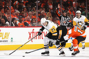 Evgeni Malkin #71 of the Pittsburgh Penguins moves the puck ahead of Sean Couturier #14 of the Philadelphia Flyers during the third period in Game Three of the Eastern Conference First Round during the 2018 NHL Stanley Cup Playoffs at the Wells Fargo Center on April 15, 2018 in Philadelphia, Pennsylvania. The Penguins defeated the Flyers 5-1.