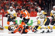 Claude Giroux #28 of the Philadelphia Flyers is checked by Jake Guentzel #59 of the Pittsburgh Penguins during the first period in Game Three of the Eastern Conference First Round during the 2018 NHL Stanley Cup Playoffs at the Wells Fargo Center on April 15, 2018 in Philadelphia, Pennsylvania.