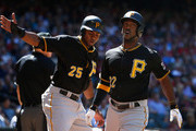 Andrew McCutchen #22 and Gregory Polanco #25 (L) of the Pittsburgh Pirates score fifth inning runs against the Arizona Diamondbacks during the MLB game at Chase Field on April 26, 2015 in Phoenix, Arizona.