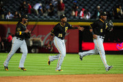 Andrew McCutchen #22, Gregory Polanco #25, and Starling Marte #6 of the Pittsburgh Pirates celebrate as they leave the field after the game against the Atlanta Braves at Turner Field on September 22, 2014 in Atlanta, Georgia.