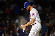 Cole Hamels #35 of the Chicago Cubs uses the rosin bag between pitches against the Pittsburgh Pirates at Wrigley Field on September 24, 2018 in Chicago, Illinois.