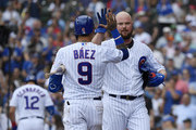 Javier Baez #9 of the Chicago Cubs congratulates Jon Lester #34 of the Chicago Cubs for his solo home run in the third inning against the Pittsburgh Pirates at Wrigley Field on July 13, 2019 in Chicago, Illinois.