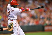 Brandon Phillips #4 of the Cincinnati Reds follows through on his second three-run home run of the night against the Pittsburgh Pirates in the sixth inning at Great American Ball Park on July 30, 2015 in Cincinnati, Ohio. Cincinnati defeated Pittsburgh 15-5.