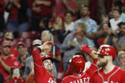 Eugenio Suarez #7 of the Cincinnati Reds is congratulated by Joey Votto #19 after hitting a two-run home run in the third inning against the Pittsburgh Pirates at Great American Ball Park on September 28, 2018 in Cincinnati, Ohio.